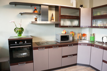 Modern kitchen interior made in brown tones