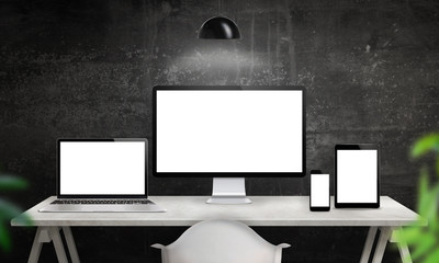 Different devices on desk with isolated screen for responsive web site design promotion. Computer display, laptop, tablet and smart phone mockup.