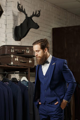 Extravagant stylish man in tailor studio.