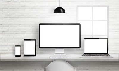 Wall Mural - Multiple devices on office desk for responsive web site design presentation. Brick white wall in background.