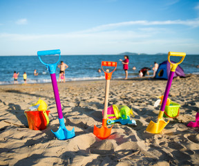 Group of children's beach toys on a sunny day.