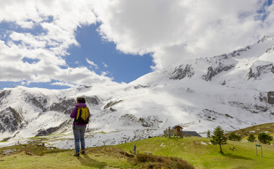 hiker in the Pyrenees mountains in spring with snow