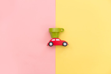 photo of car shaped toy and empty cup on the wonderful background in pop art style