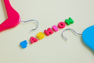 photo of wooden hangers and colorful letters on the wonderful yellow background