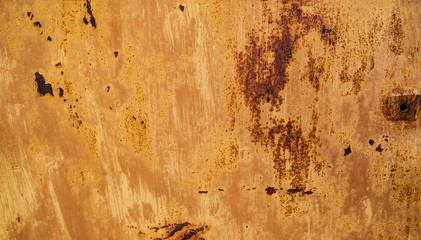 abstract background with the hole on the right and the texture of the rust orange-brown colored with spots