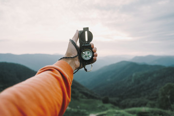 POV image with compass in mountains