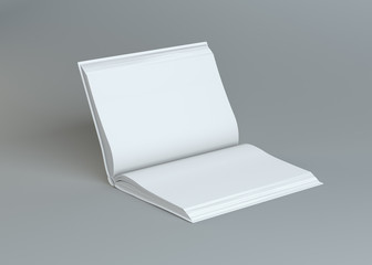White empty open book on gray background