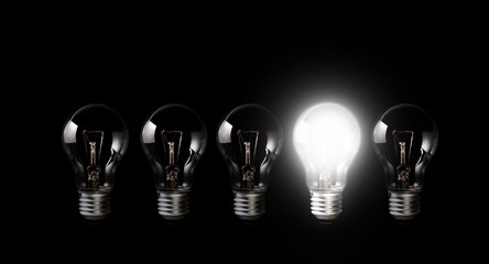 Light bulbs with glowing one outstanding dark background.Business, motivation concept ideas.