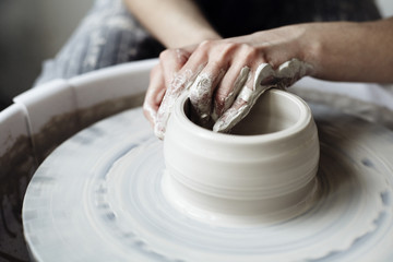 The woman's hands close up, the masterful studio of ceramics works with clay on a potter's wheel Fototapete