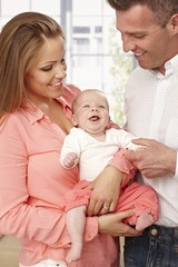 Happy family with smiling baby