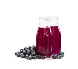 Blueberry  juice in glass bottles