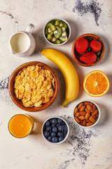 Healthy breakfast - bowl of corn flakes, berries and fruit