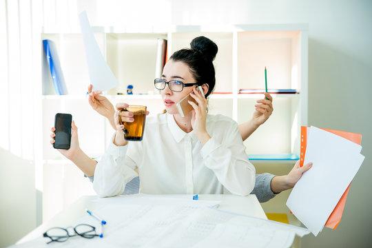 Successful businesswoman multitasking