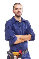 Young worker standing with arms crossed on white background