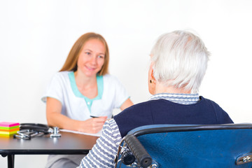 Elderly woman at the doctor