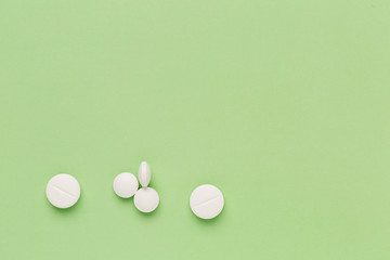 Fotobehang Round white pills on colorful background