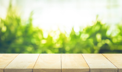 Empty of wood table top with blur green garden background.For create product display or key visual layout.clipping path