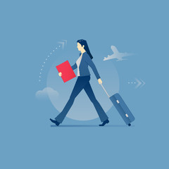 Young business woman carrying a luggage in business travel