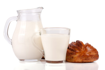 jug and glass of milk with a loaf of bread isolated on white background