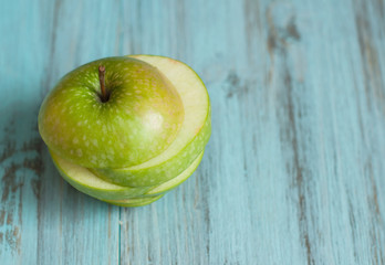 Green apple on a wooden background. The concept of a healthy diet.