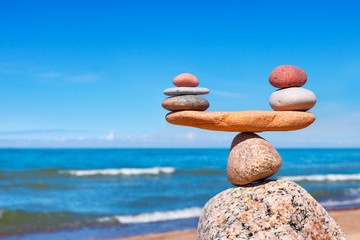 Concept of harmony and balance. Balance stones against the sea. Wall mural