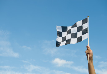 checkered race flag in hand.