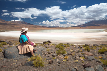 Bolivian woman in traditional costume on a high-altitude lagoon on the plateau Altiplano, Bolivia Fotoväggar
