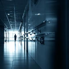 People walking through the hospital corridor.