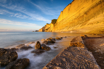 Logas the Sunset Beach and amazing rocky cliff in Peroulades. Corfu Island. Greece.
