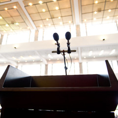 Speaker's table in conference room.