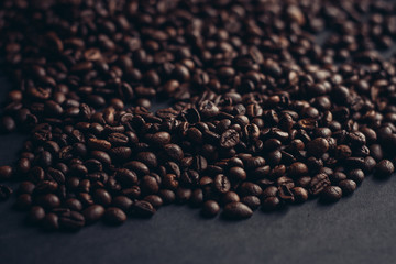 brown coffee beans on a gray background
