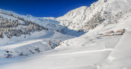 Trees and skiing slopes covered by fresh new snow in Tyrolian skiing resort  Zillertal arena, Austria.
