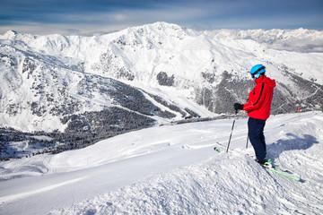 Fototapete - Man enjoying the stunning view before freeride skiing in famous ski resort in Tyrolian Alps, Zillertal, Austria