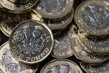 stack of new pound coins introduced in Britain in 2017, front and back