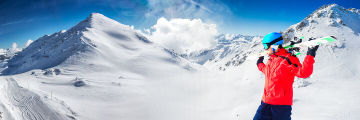 Man enjoying the stunning view before skiing in famous ski resort in Tyrolian Alps, Zillertal, Austria