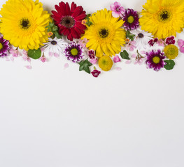 Flowers on a white board with space for copy