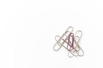 Office supplies. Paper clips. On white background with copy space.