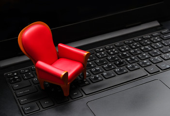 Close up mini red seat on black laptop keyboard,Live streaming video watching concept,vip seat