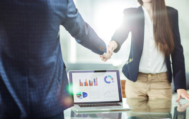 handshake business partners near the workplace