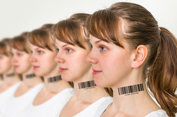 A lot of women in a row with barcode - genetic clone concept