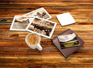Old photos, photo album, cup of fragrant coffee on a wooden table. Collage in 3D. Quality Render