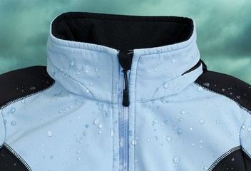 Softshell jacket  with rain drops. Cloudy sky in the background.