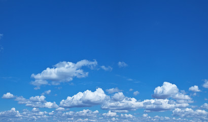 Heap clouds in the blue sky.
