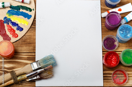 """Set of different brushes and acrylic paints to paint ..."