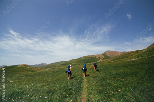 fc0ed30764 Group of friends journey on a holiday hiking trip backpacking through the  mountains and camping long