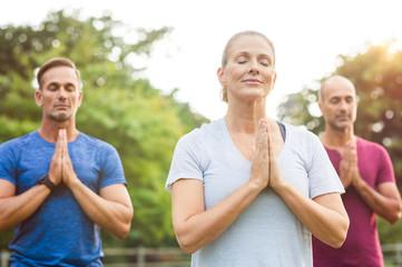 Class of yoga meditating
