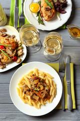 Tasty chicken marsala with pasta on table