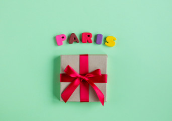 photo of cute gift and colorful letters on the wonderful green studio background