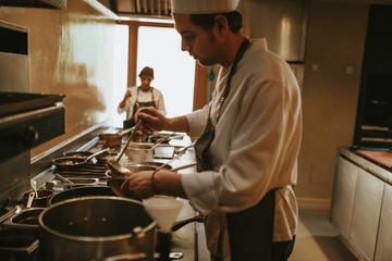 A person on restaurant kitchen