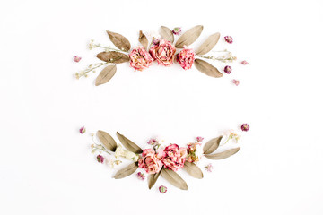 Round frame wreath with roses, pink flower buds, branches and dried leaves isolated on white background. Flat lay, top view. Flower mockup background